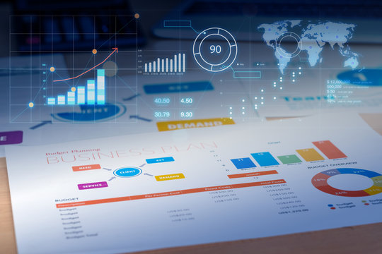 Business plan with financial graph and future growth glowing diagram and laptop at background