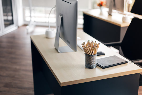 Minimal office workplace modern style. Wooden desk with pencil.