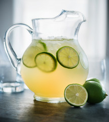 Pitcher of margaritas with lime