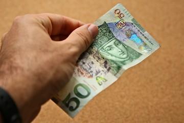 Georgian money in human hand. 50 Lari banknote.