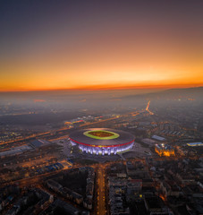 Budapest, Hungary 2020.01.12 - Aerial panoramic view of Budapest at dusk with a golden sunset. This view includes the brand new illuminated Ferenc Puskas Stadium aka Puskas Arena