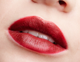 Closeup macro portrait of female red smiling lips with day beauty makeup.
