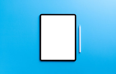 digital tablet and stylus pen on light blue background Fotobehang