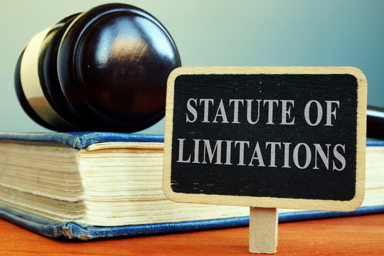 Statute of limitations sign, book and gavel.