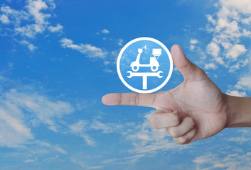 Hand pressing service fix motorcycle with wrench tool flat icon over blue sky with white clouds, Business repair motorbike service concept