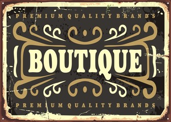 Vintage boutique sign with decorative elements on black background. Fashion business poster template. Vector illustration. Wall mural