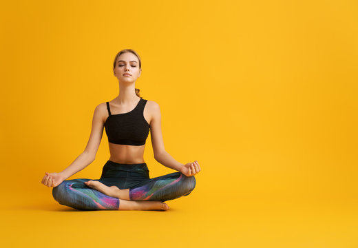 Woman is practicing yoga and meditation