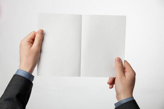 Bi-fold A4 paper brochure, A5 flyer mockup. Template of booklet (leaflet) in hands.
