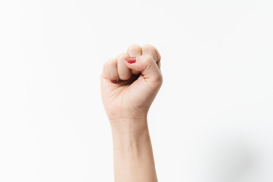 Woman's hands with fist gesture on a white background
