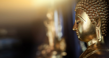 Foto auf AluDibond Buddha Selective focus close-up shots of of the Buddha images with soft light and layout design for a beautiful religious background.