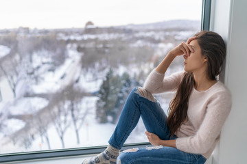 Seasonal affective disorder SAD depression winter season anxious alone young girl feeling lonely - stress, anxiety, melancholy emotion at home. Mental health problem.