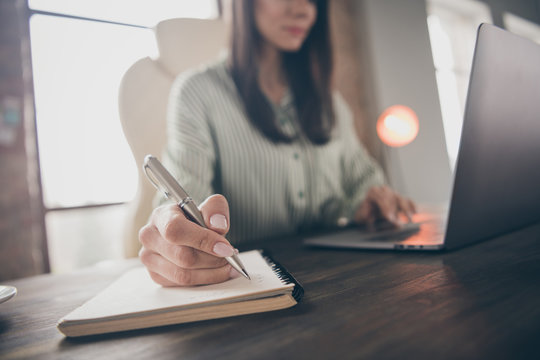 Cropped view portrait of nice attractive busy lady qualified expert shark lawyer attorney specialist writing case notes researching at modern industrial brick loft interior style work place station