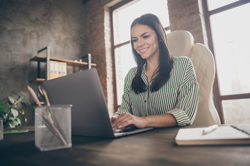 Photo of attractive latin business lady notebook table chatting colleagues read corporate report wear striped shirt sitting chair modern interior office indoors