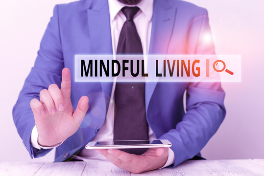 Text sign showing Mindful Living. Business photo showcasing Having a sense of purpose and setting goals in life Businessman with pointing finger in front of him