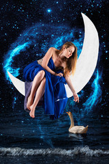 A blonde girl, an alien from another galaxy, is sitting on the Moon, hanging over a swan and over the waves of unlimited water and space. Fantastic production. Elements of this image furnished by NASA
