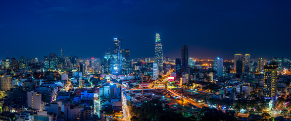 Papiers peints Bleu nuit Cityscape of Ho Chi Minh City, Vietnam at magic hour