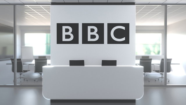 BBC logo above reception desk in the modern office, editorial conceptual 3D rendering