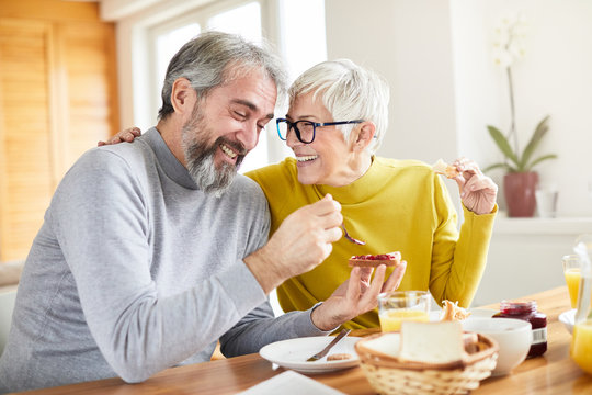 senior couple breakfast home food lifestyle eating table