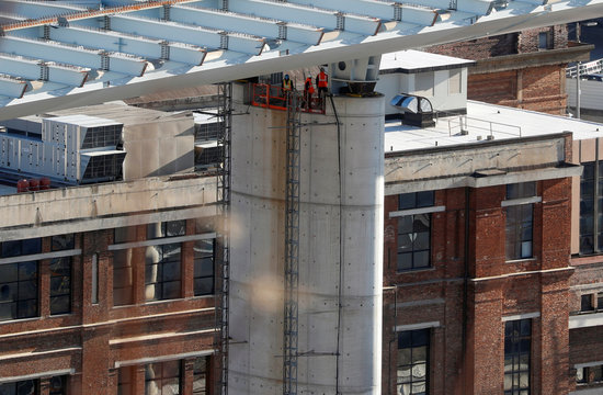 Builders work on one of the eighteen 40 metre-high columns that will support the new Genoa bridge, also known as the Polcevera viaduct