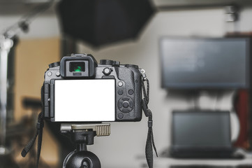 Mock up of a professional camera, in a photo studio, against the background of softbox light sources.
