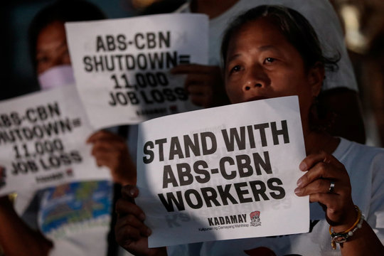 Supporters of ABS-CBN, the country's top broadcast network, hold a rally against the Philippine government's move to scrap its franchises, in Quezon City, Metro Manila,