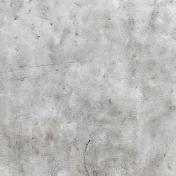 Weiß gestrichene glatte Betonwand mit Gebrauchsspuren