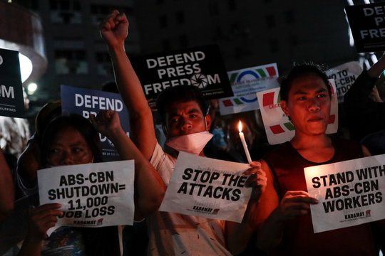 Supporters of ABS-CBN, the country's top broadcast network, hold a rally against the Philippine government's move to scrap its franchises, in Quezon City, Metro Manila