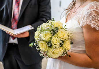 Wedding bouquet of flowers held by bride closeup. yellow roses flower