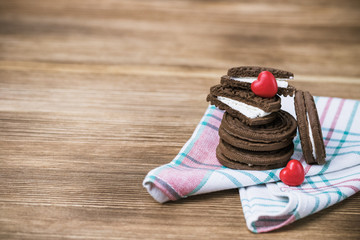 chocolate cookie sandwich on a wooden background. wooden and red hearts. happy Valentine's day. beautiful picture with biscuits. international women day, women's day