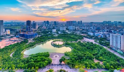 Hanoi skyline cityscape at twilight period. Cau Giay park, west of Hanoi Fototapete