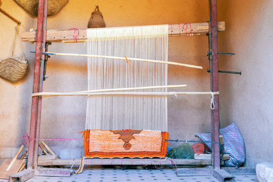 Weaving loom with berber carpet in Morocco