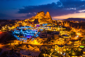 Wall Mural - Aerial view of Uchisar Castle at night in Cappadocia, Turkey.