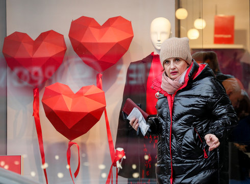 A woman leaves a store decorated for Valentine's Day in central Kiev