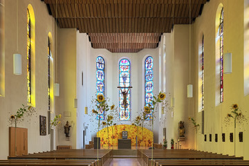 Friedrichshafen, Germany. Interior of Catholic Church of St. Nicholas, decorated for Pentecost and Trinity Sunday. Church was first mentioned in 1293, destroyed by bombs in 1944 and restored after WW2