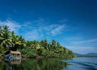 boat and jungle hut on the tatai river in cambodia Fototapete
