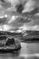 Aluminium Prints Dark grey Stunning Autumn Fall landscape of Hawes Water with epic lighting and dramatic sunlight in Lake District