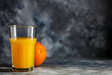 Fresh orange juice and copy space for your product.