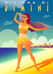 Girl on the beach on the Adriatic coast in Rimini, Italy.
