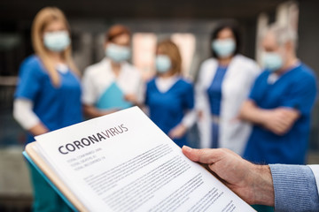 Group of doctors talking about corona virus on conference.
