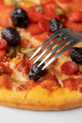 closeup of an fork on italian pizza