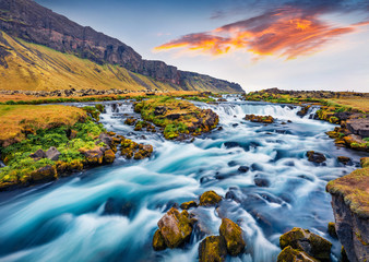 Printed roller blinds Waterfalls Romantic summer view of small waterfall near Bjodvegur road. Impressive sunrise on Iceland, Vik location. Beauty of nature concept background.
