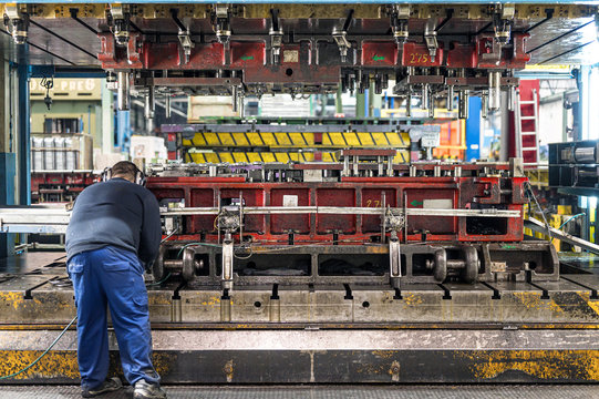 The hydraulic bending machine operation by technical operator. Sheet metal manufacturing process by hydraulic bending machine .