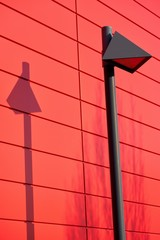 modern lamp on the facade of a red house