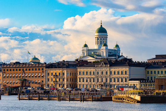 Helsinki. Finland. St. Nicholas. Cathedrals. Embankment of the Finnish city. Suurkirkko Temple in Helsinki. Finnish Capital on a sunny day. Domes of the Orthodox Church rise above the buildings