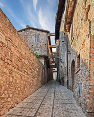 Montefalco, Perugia, Umbria, Italy: ancient narrow alley with arches in the medieval village