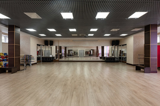 large and light hall with mirrors, music, equipment for dancing, sports. Group fitness room. Modern interior design. Fitness workout. Fitness gym background. Gym equipment background. Empty space.