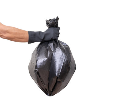 Hand holding trash bag isolated on white background, clipping path