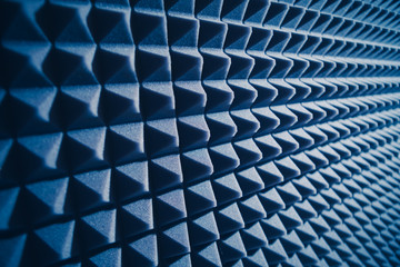 acoustic foam material for sound dampering, blue background