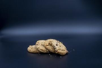 Closeup studio shot of chocolate chip cookies with dark blue background