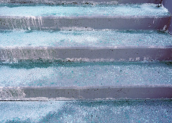 Melting salt on the stair steps in winter season